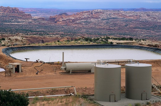 Oil well waste pit on Utah state land section on rim of Long Canyon less than 1/4 mile from Deadhorse Point State Park and 3 miles from Canyonlands National Park, Utah. : Stock Photo