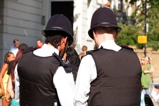 Stock Photo: 1840-35037 West London Ladbroke Grove A Metropolitan Police Constable Sporting Dreadlocks.