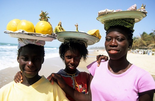 Gambia Girls Selling Fruit On The Beach : Stock Photo