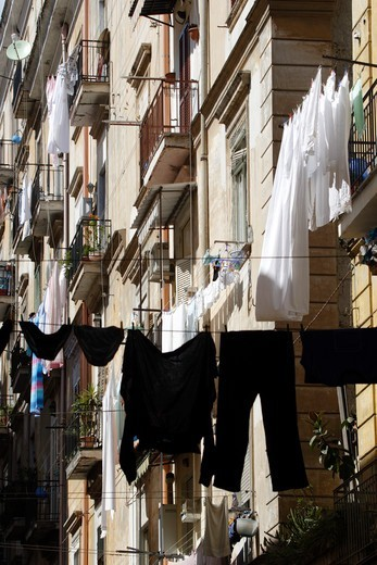 Washing Hanging Out Of Apartment Building In A  Street In Historic Center Of Naples, Campania, Italy : Stock Photo