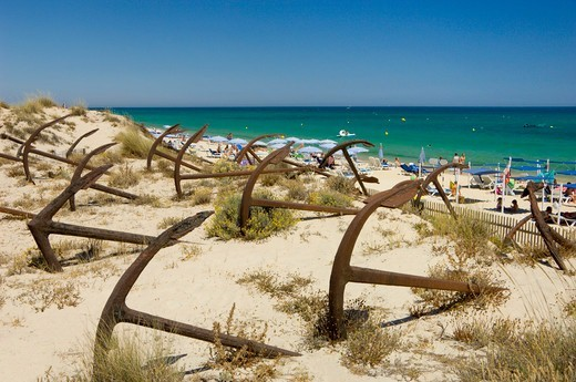 Stock Photo: 1840-38731 Eastern Algarve (the Sotavento), Old Anchors On The Dunes On The Praia Do Barril, Near Tavira