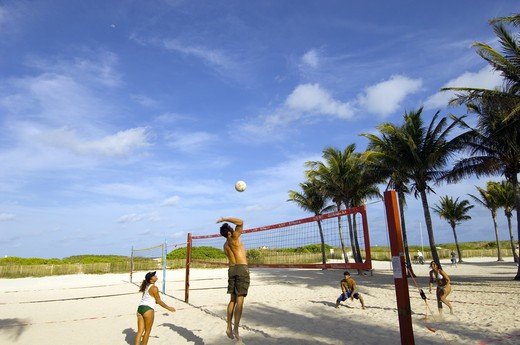 Young People Playing Beach Volleyball, South Beach, Miami. : Stock Photo