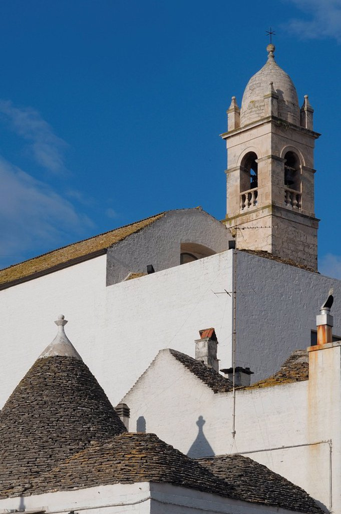 Stock Photo: 1841-101106 Church and roof of a trullo, Alberobello, Italy