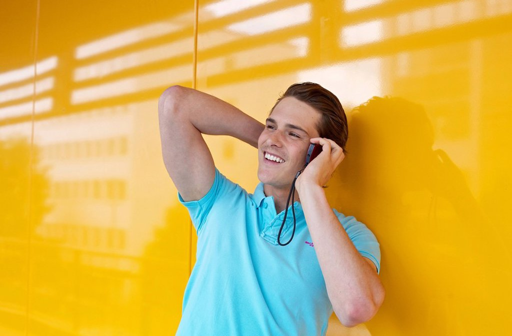 Young man on cell phone : Stock Photo