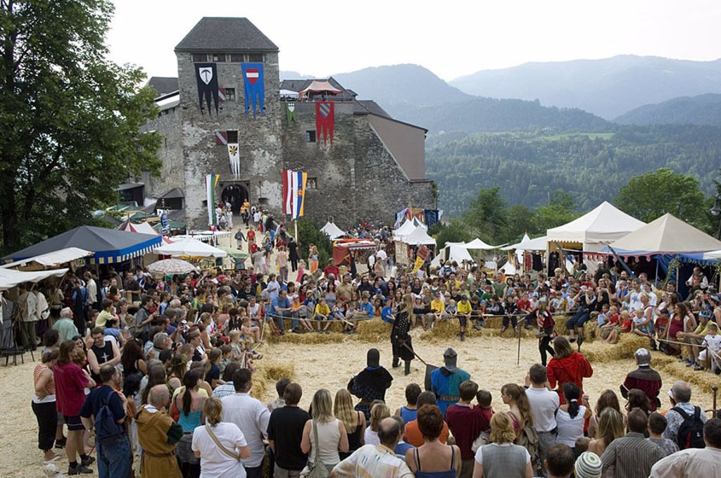 Crowd watching historical reenactment, Austria : Stock Photo