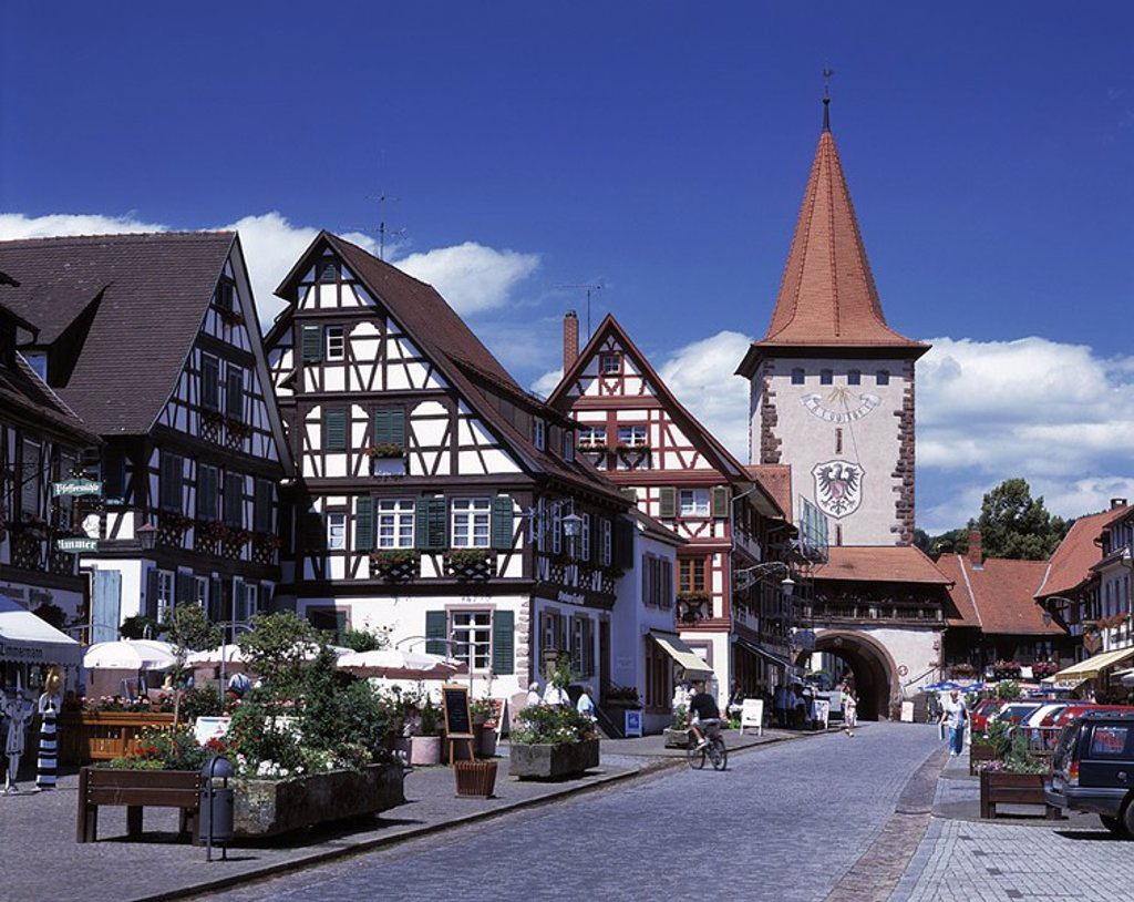 Stock Photo: 1841-1099 People on street leading to archway, Black Forest, Baden_Wurttemberg, Germany