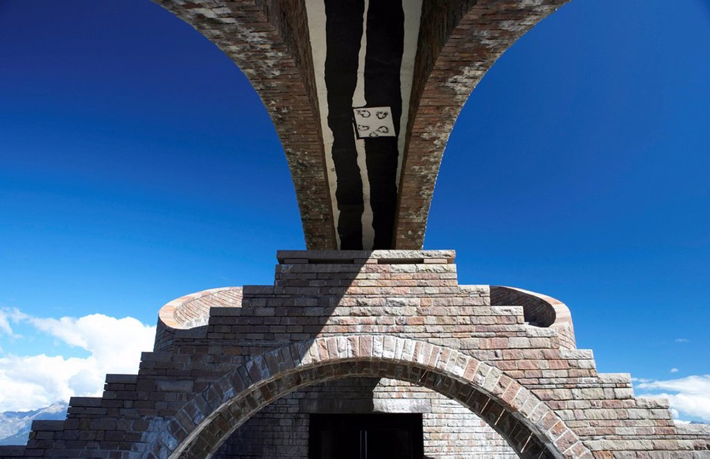Low angle view of building against blue sky, Monte Tamaro, Switzerland : Stock Photo