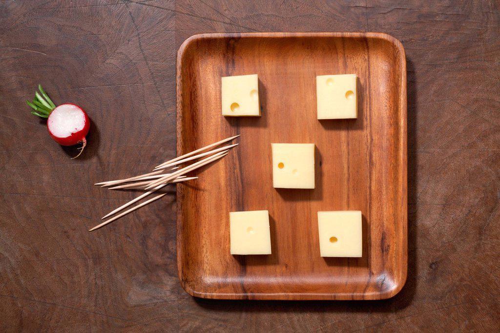 Stock Photo: 1841-115385 Cheeseboard, toothpicks and radish