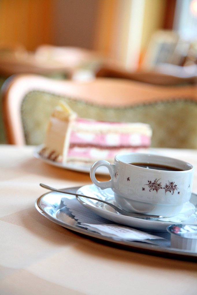 Stock Photo: 1841-115386 Coffee and cake in a cafe