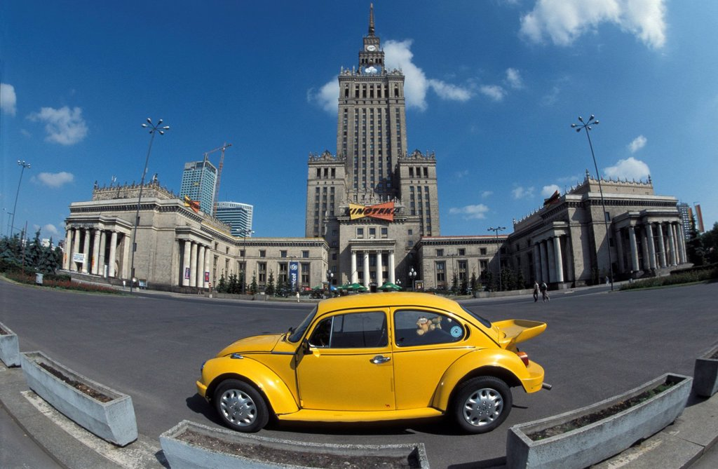 Cultural Palace and yellow VW beetle, Warsaw, Poland, Europe : Stock Photo