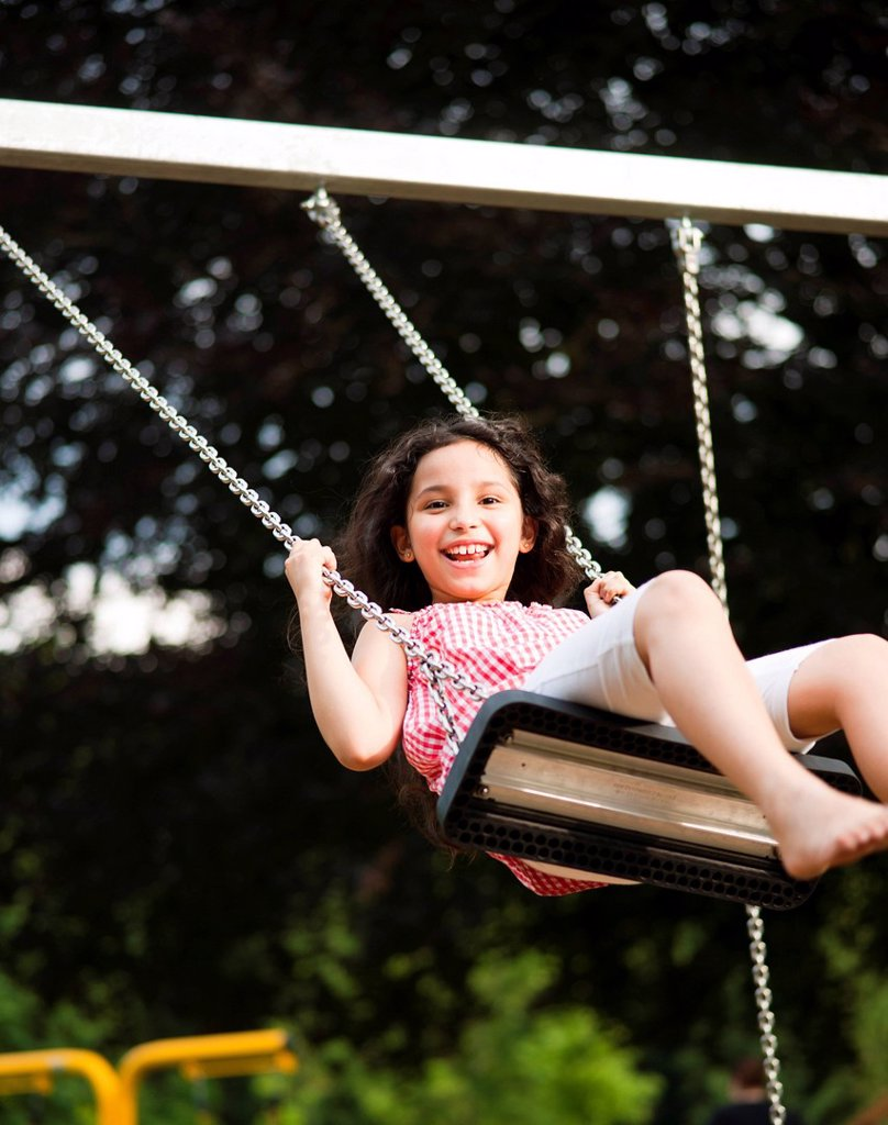 Stock Photo: 1841-119337 Happy girl on swing