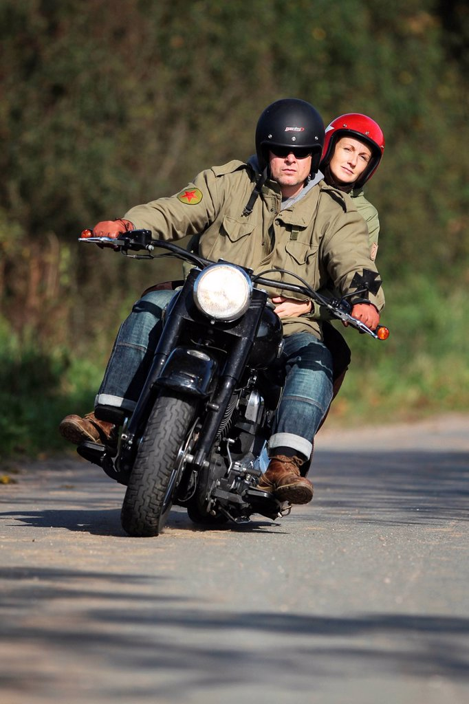 Stock Photo: 1841-120760 Couple riding motorbike on a country road