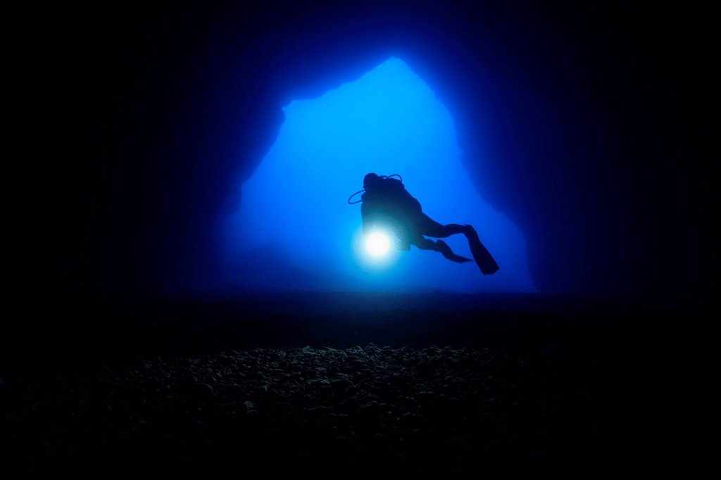 Stock Photo: 1841-121940 Diver in the entry of a cave, Mediterranean Sea near Gozo, Malta, underwater shot
