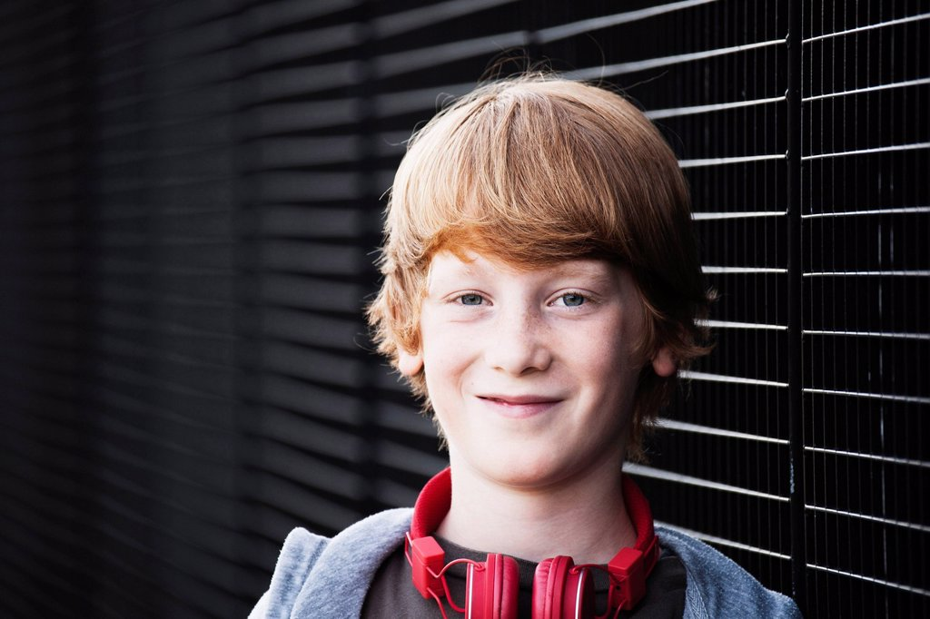 Stock Photo: 1841-122826 Smiling redheaded boy, portrait