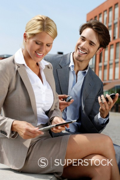 Stock Photo: 1841-123843 Two young business people