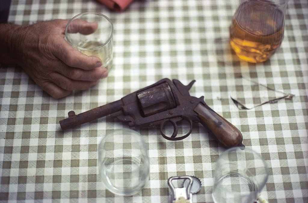 Outdoors drink cheers Conversation Drink Glass right hand Bottle-opener Beer lid pistol Outlet Granule Arm Gun genuine Antique Antique revolver War Find Memory Heritage inherited story telling stories cut specify : Stock Photo