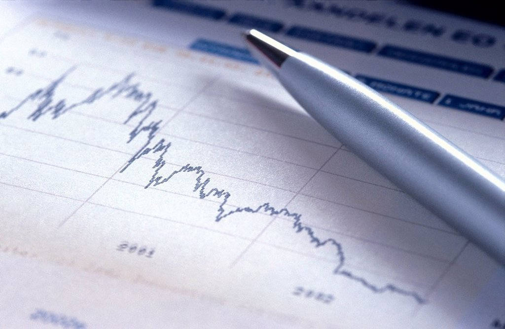 Close_up of line graph and pen : Stock Photo