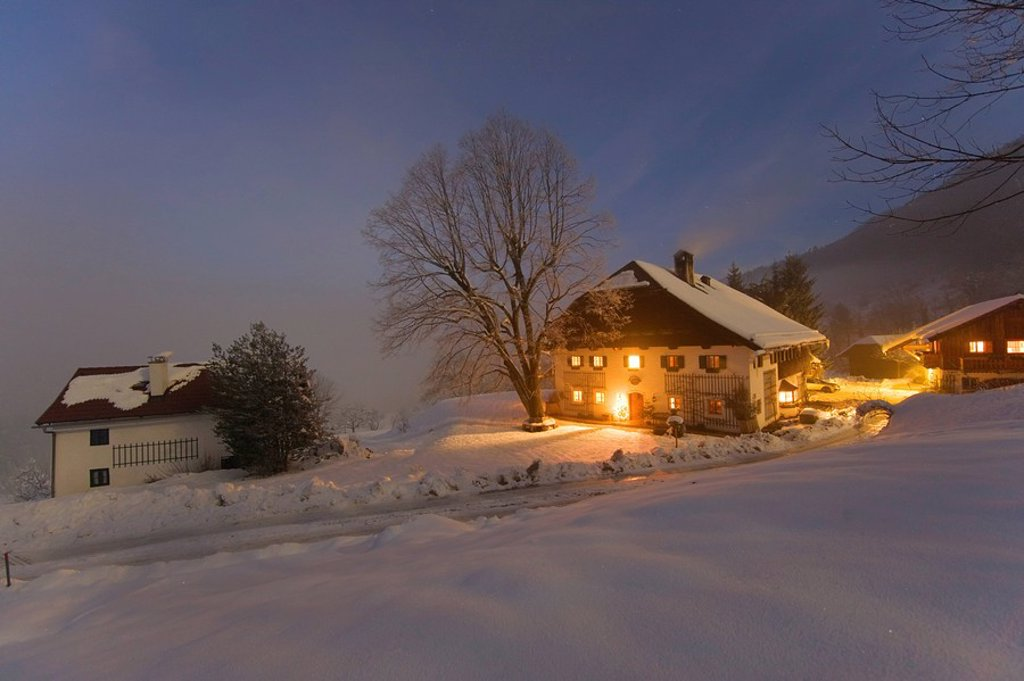 Farmhouse lit up at dusk, Gaisberg, Austria : Stock Photo