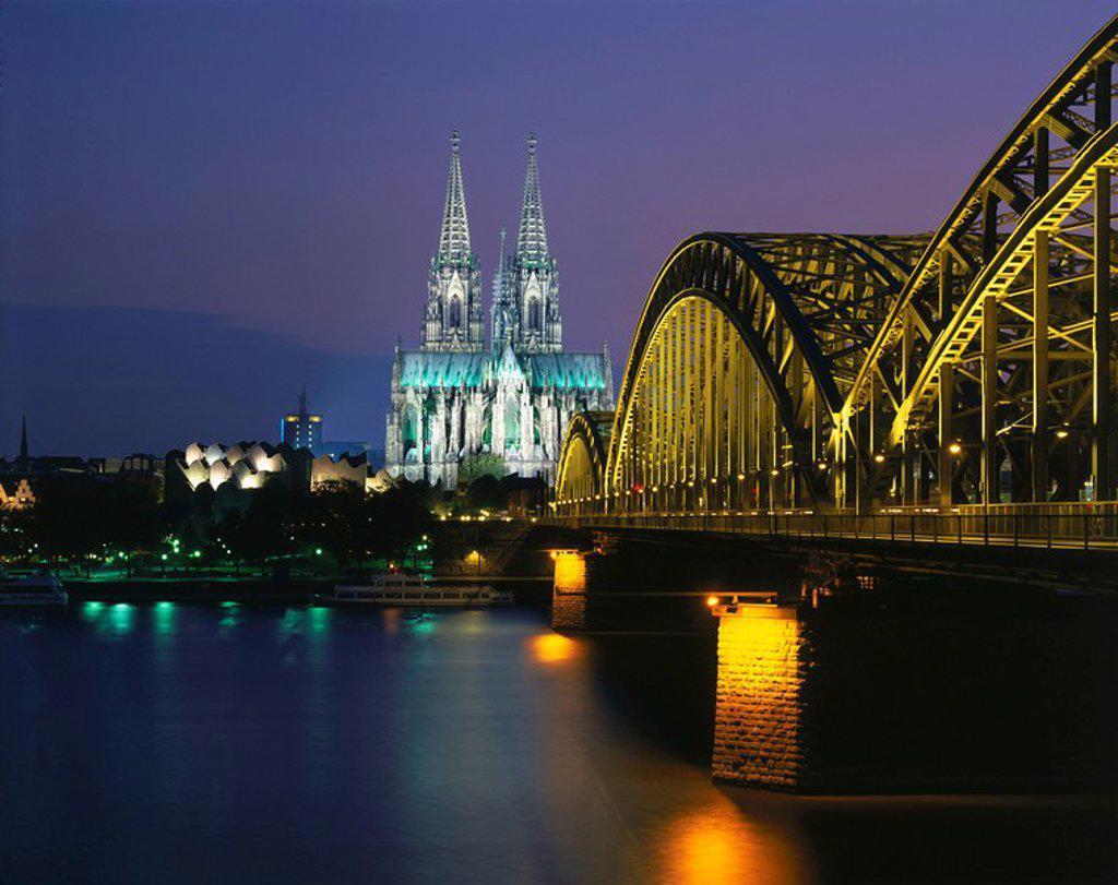Railroad Bridge across river at dusk, Hohenzollern Bridge, Cologne, Germany : Stock Photo