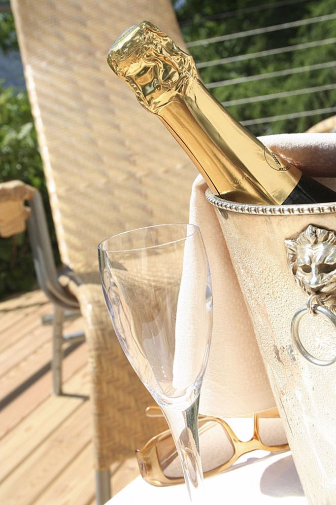 Close_up of champagne bottle in a champagne bucket on table : Stock Photo