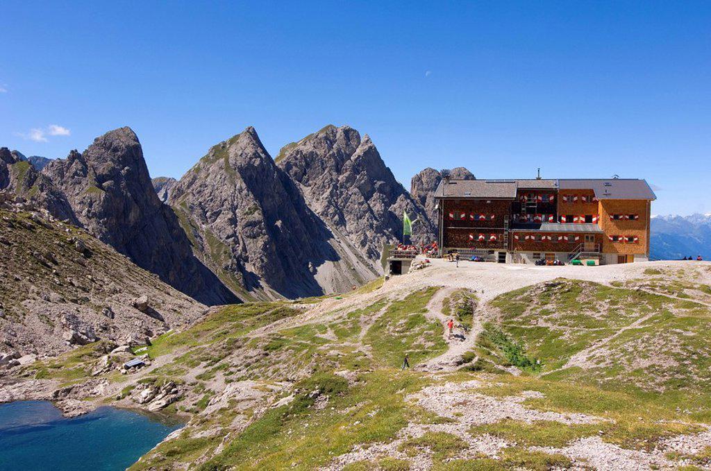 Building near mountains, Lienzer Dolomiten, Lienz, Tyrol, Austria : Stock Photo