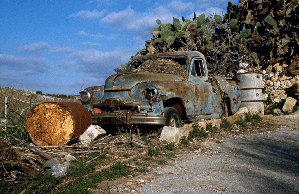 Stock Photo: 1841-16260 Wrecked car at roadside, Malta