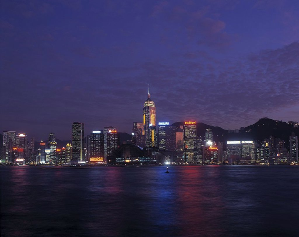 City at waterfront lit up at night, China : Stock Photo