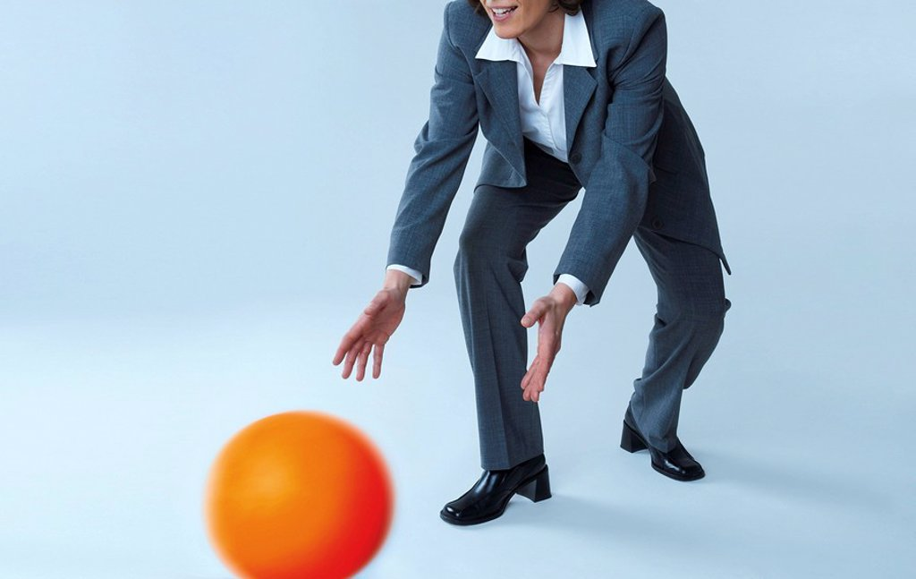 Stock Photo: 1841-18276 Businesswoman catching ball