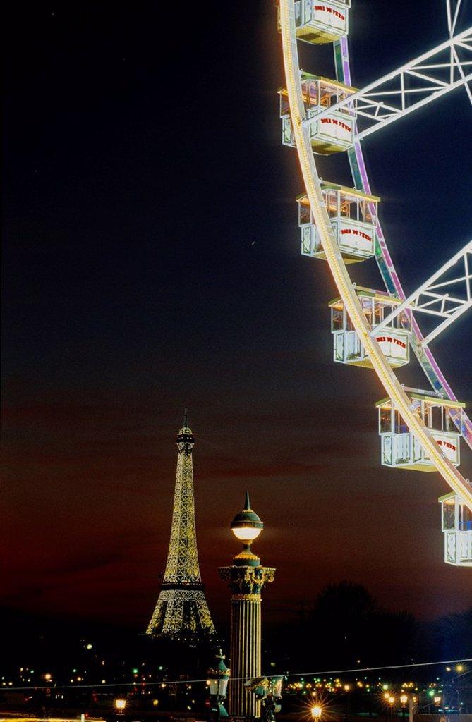 Ferris wheel at amusement park, Paris, Ile_de_France, France : Stock Photo