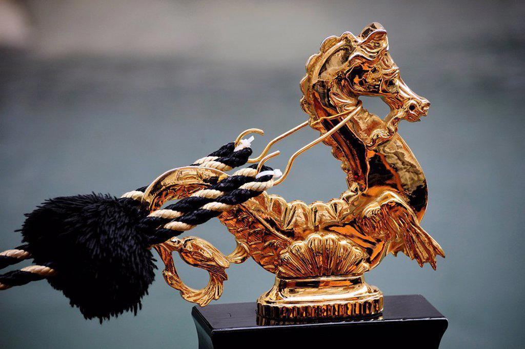 Close_up of gilt statue of seahorse on gondola, Venice, Veneto, Italy : Stock Photo