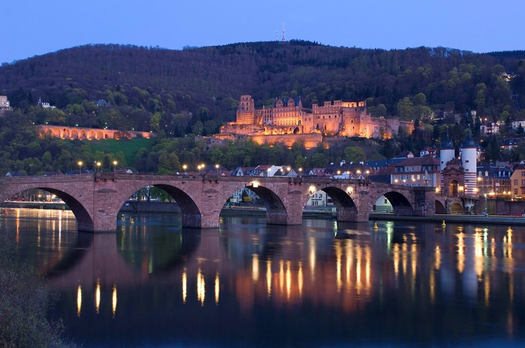 Stock Photo: 1841-19359 Arch bridge across river lit up at dusk, River Neckar, Heidelberg, Germany