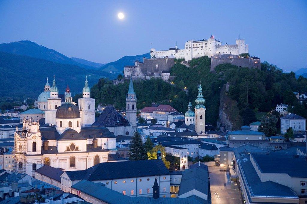 Church in town with castle on hill in background, Kollegienkirche, Hohensalzburg Fortress, Salzburg, Austria : Stock Photo