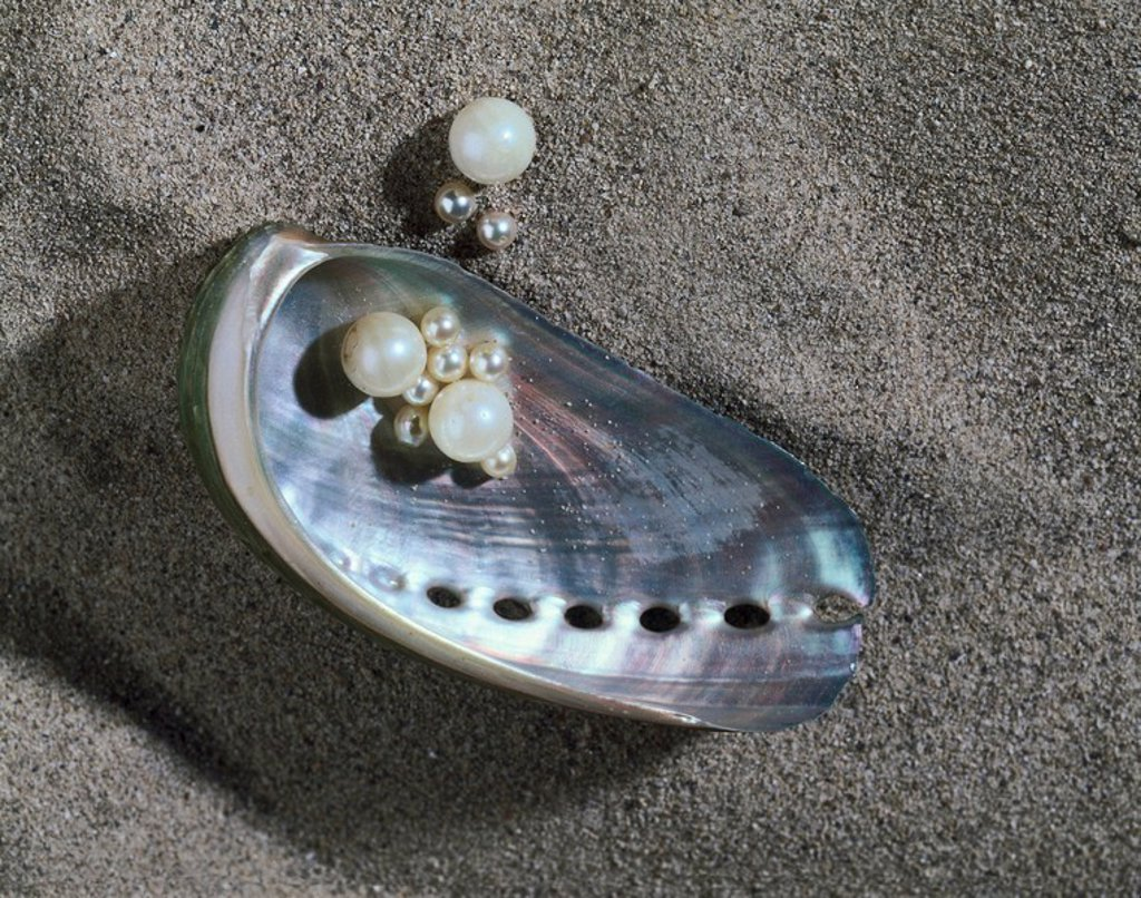 Close_up of shell and pearls on sand : Stock Photo