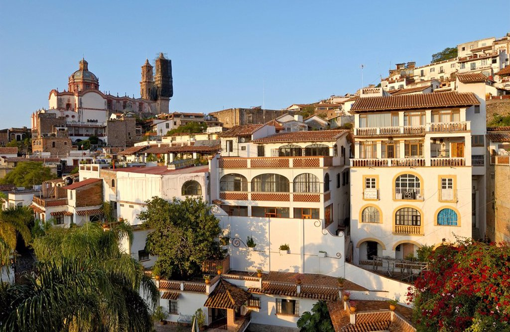 Buildings in city with church in background, San Sebastian y Santa Prisca, Taxco de Alarcon, Guerrero, Mexico : Stock Photo