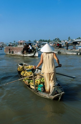 Stock Photo: 1841-2218 Woman rowing boat containing fruits and vegetables, Can Tho, Mekong Delta, Vietnam
