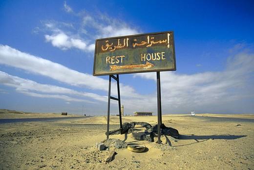 Signboard on arid landscape, Egypt : Stock Photo