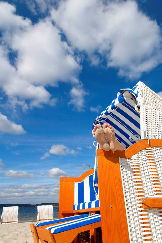 Stock Photo: 1841-22578 Feet in beach chair, Gluecksburg, Schleswig_Holstein, Germany