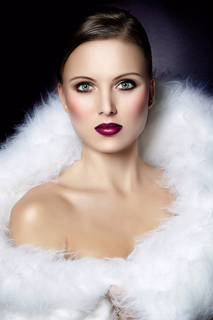Young woman in white fur, portrait : Stock Photo