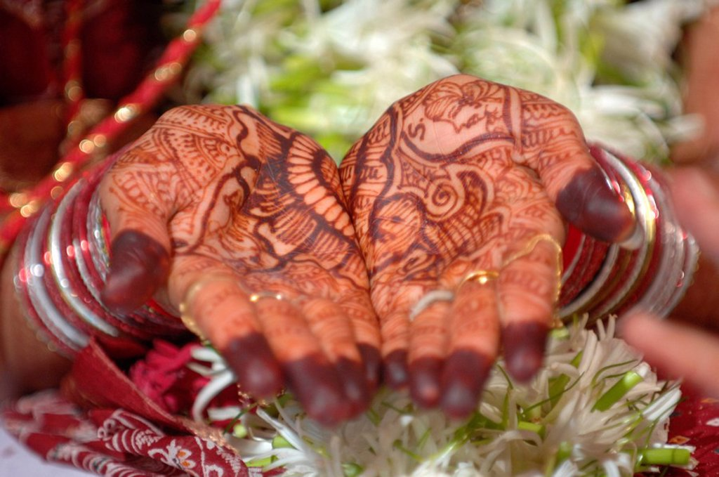 Henna tattoo on woman´s palm : Stock Photo