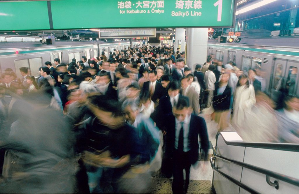 Commuters hurrying on escalator in subway, Tokyo Prefecture, Japan : Stock Photo