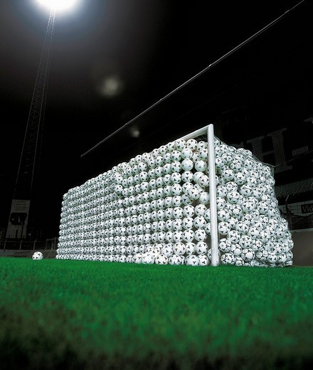 Stock Photo: 1841-24197 Goal full of soccer balls in stadium