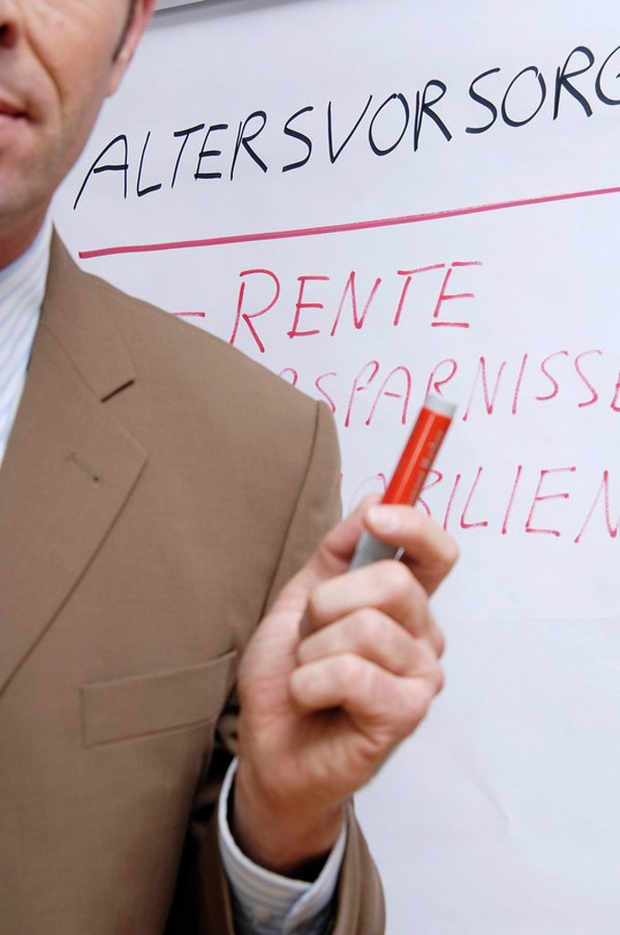 Close_up of businessman giving presentation in seminar : Stock Photo