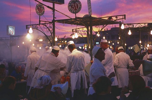 Chefs cooking food in open area at restaurant, Djemma El Fna Square, Marrakesh, Morocco : Stock Photo