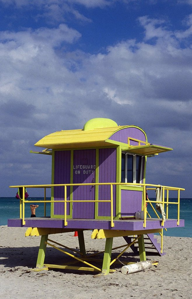Stock Photo: 1841-25897 Lifesaver Life Guard Beach house colored yellow blue Shore Sandy beach Sea Ocean save Sky blue white Clouds Lifeguard Lifesaver Baywatch Rescue Florida USA