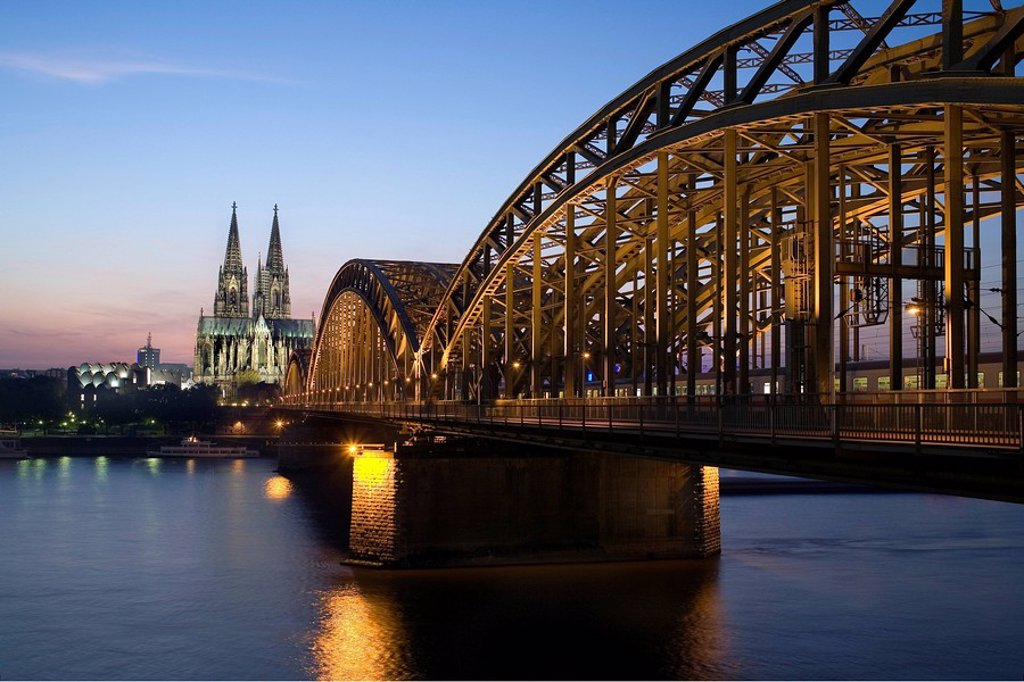 Stock Photo: 1841-26192 Bridge and church lit up at dusk, Hohenzollern Bridge, Cologne Cathedral, Cologne, Rhineland, North Rhine_Westphalia, Germany
