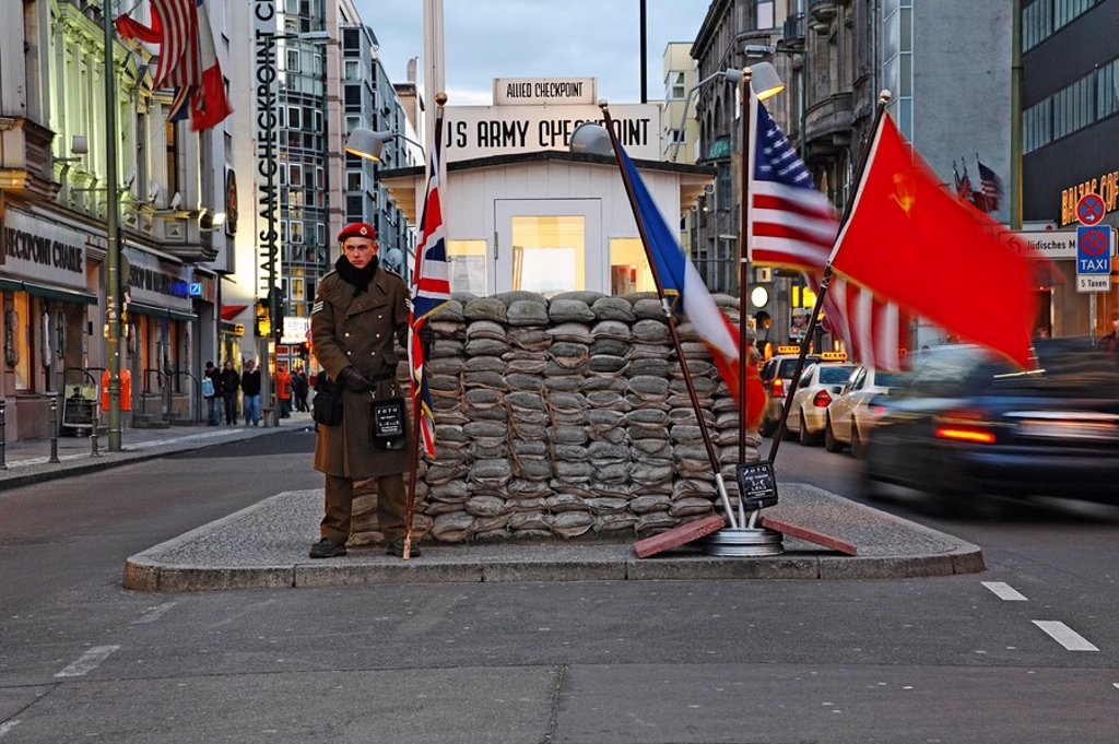 Policeman standing at checkpoint, Checkpoint Charlie, Berlin, Germany : Stock Photo