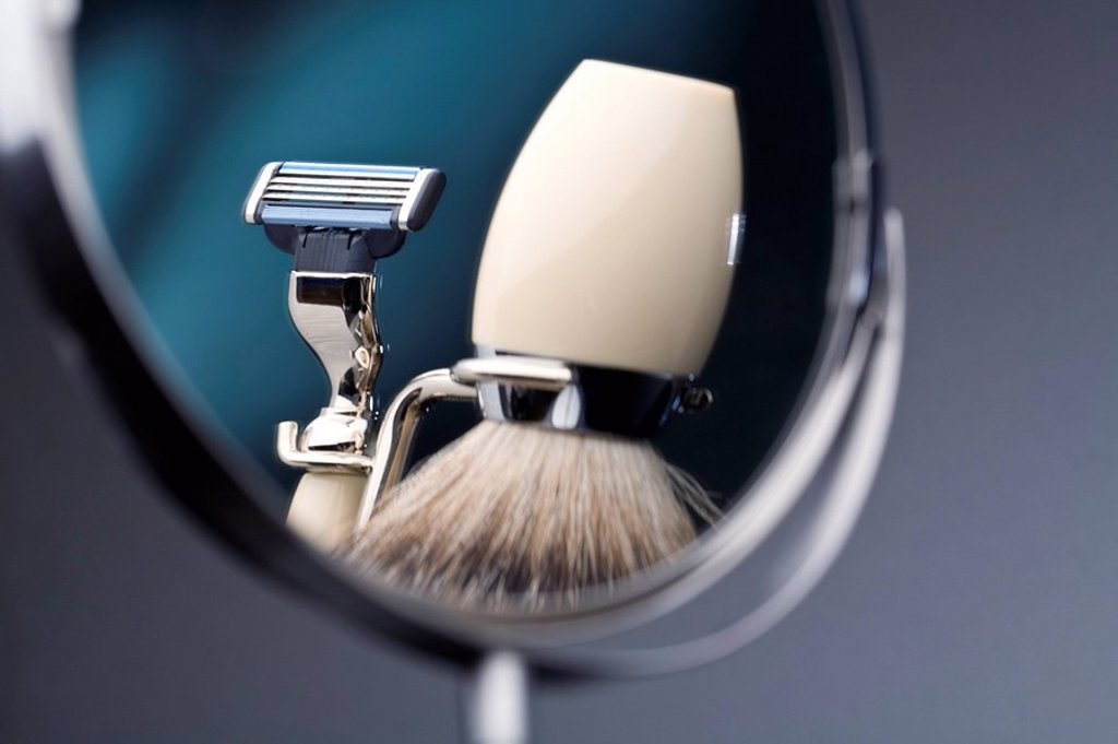 Reflection of shaving brush and razor in mirror : Stock Photo