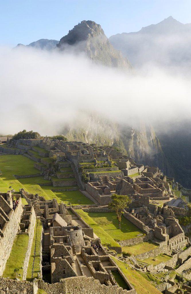 Stock Photo: 1841-27198 Clouds over old ruins on mountain, Inca Ruins, Machu Picchu, Cusco Region, Peru