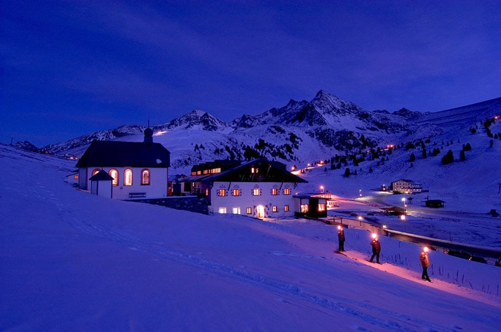 Stock Photo: 1841-27505 Houses lit up at night on snow covered landscape, Austria