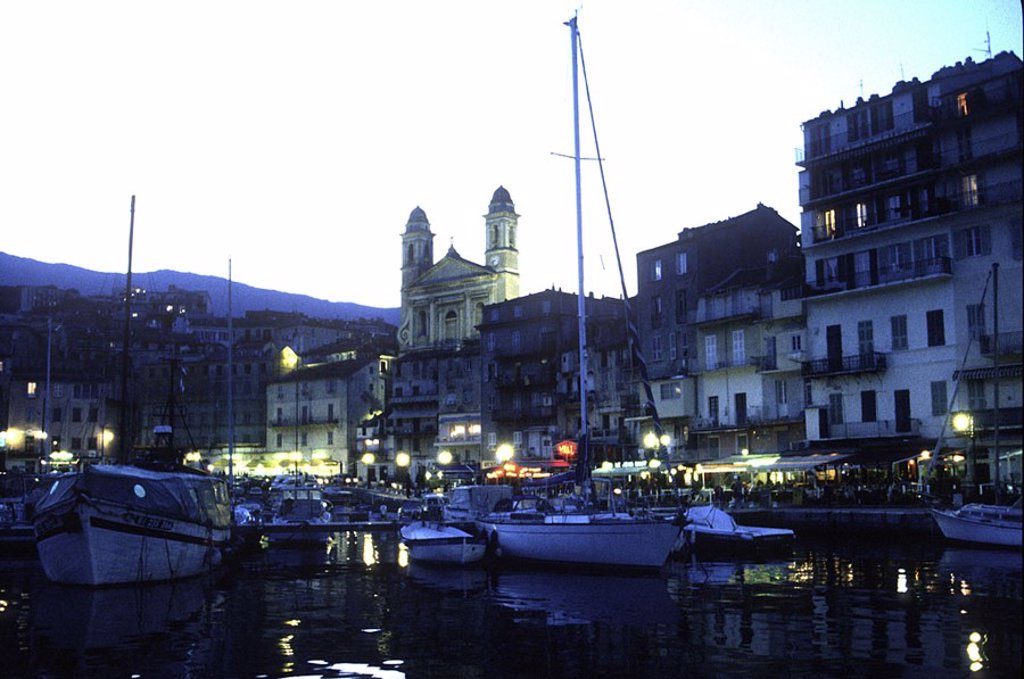 Stock Photo: 1841-28484 Boats in harbor lit up at dusk, Bastia, France